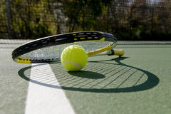 Tennis Racket and ball on white Royalty Free Stock Photos