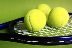 Tennis racket and balls. Tennis rackets and balls on a green background Royalty Free Stock Photography