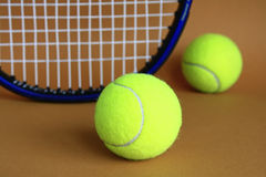 Tennis racket and balls. On a brown background Stock Photos