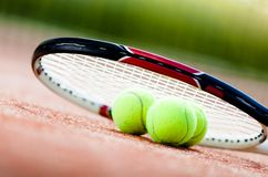Tennis racket with balls Royalty Free Stock Photography