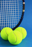 Tennis. Racket and balls on a blue background Royalty Free Stock Image