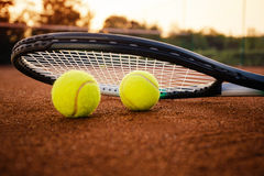 Tennis racket with balls on clay Royalty Free Stock Image