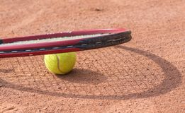Tennis racket and balls on the clay court Royalty Free Stock Photography