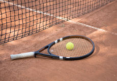 Tennis racket and balls on the clay court Stock Photography