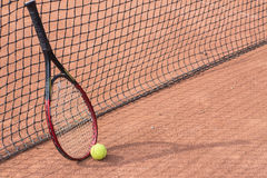 Tennis racket and balls on the clay court Stock Photo