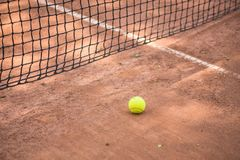 Tennis racket and balls on the clay court Stock Images