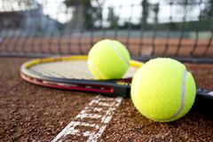 Tennis racket and balls on the clay tennis court. stock photos