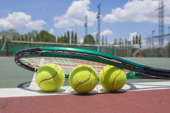 tennis racket and balls on the tennis court Royalty Free Stock Images