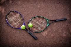 Tennis racket and balls on the tennis court Stock Images