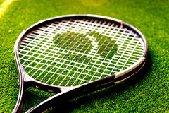 Tennis racket on green background close up Stock Image