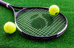 Tennis racket on green background close up Stock Images