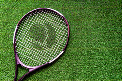Tennis racket on green background top view Royalty Free Stock Photos