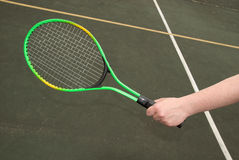 Tennis racket in hand Royalty Free Stock Photography