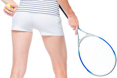Tennis racket in the hands of the sportswoman. Rear view close-up Royalty Free Stock Image
