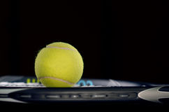 Tennis racket isolated on black background Stock Photography