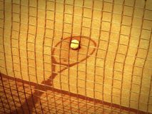Tennis racket and net shadow (149). Tennis racket and net shadow with ball in the tennis court old photo look Stock Image