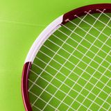 Tennis racket over synthetic surface Royalty Free Stock Image