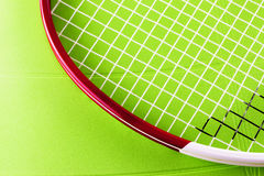 Tennis racket over synthetic surface Stock Images