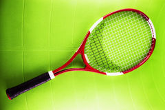 Tennis racket over synthetic surface Royalty Free Stock Images