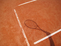Tennis racket shadow 2. The shadowof a tennis racket on the tennis court Royalty Free Stock Image