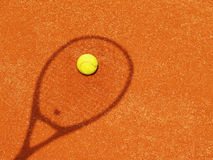 Tennis racket shadow with ball (55). Tennis racket shadow with yellow ball outside in the tennis court Stock Photo