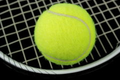 Tennis racket and tennis ball. Tennis racket, tennis ball,  on black background Royalty Free Stock Image