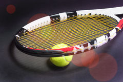 Tennis Racket with Tennis Ball on Black Royalty Free Stock Photography