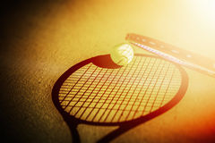 Tennis racket and tennis ball on the court Royalty Free Stock Photos