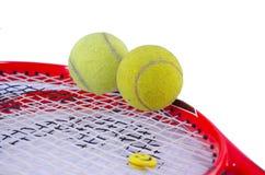 Tennis racket with two tennis balls Stock Photos