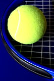 Tennis rackets and ball 1. Tennis racquet and ball isolated - on a blue background Royalty Free Stock Images