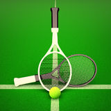 Tennis rackets and balls on a green background. Stock Image