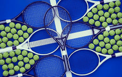 Tennis rackets with balls on hard surface court. Royalty Free Stock Image