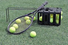 Tennis rackets, balls and shoes Stock Photo