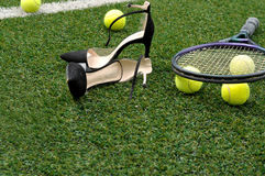 Tennis rackets, balls and shoes Stock Photography