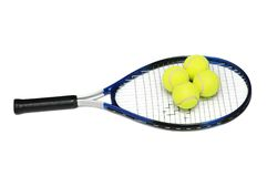 Tennis rackets and four balls Stock Photo