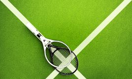 Tennis rackets on hard surface court. Tennis backgrounds Royalty Free Stock Photos