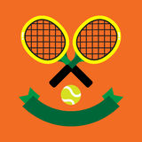 TENNIS RACQUET CLAY COURT. 2 tennis racquets with the green tennis ball decorated with green banner on brown background Royalty Free Stock Photos