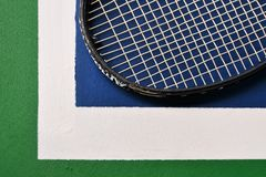Tennis racquet on the tennis court. Tennis racquet just on the white  line Royalty Free Stock Image