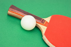 Tennis racquets on  green table Stock Photos
