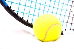 Tennis raquet with a tennis ball. Close up of tennis balls with tennis raquet royalty free stock photography