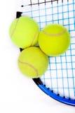 Tennis raquet with a tennis balls. Close up of three tennis balls on a tennis raquet Stock Photography
