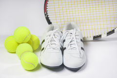 Tennis Raquet,Tennis  Balls and Sneakers against white. Horizont Stock Photo