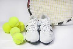 Tennis Raquet,Tennis Balls and Sneakers against white. Horizont. Tennis sports Concept: Raquet, Balls and Sneakers against white. Horizontal Image Stock Photo