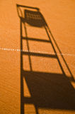 Tennis referee chair shadow Royalty Free Stock Image