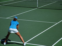 Tennis Return. Female preparing to return a serve royalty free stock image