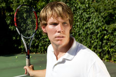 Tennis Return Shot. An up close shot of a tennis player ready to hit a forehand back Stock Photography