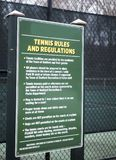 Tennis rules regulation sign public town tennis courts Bedford, New York royalty free stock image