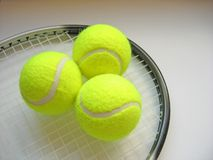 Tennis Scene 2. Tennis balls on racquet head stock image