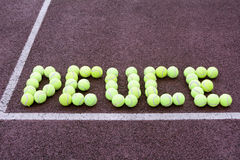 Tennis Score Deuce. Created using tennis balls on a hard court surface Stock Images