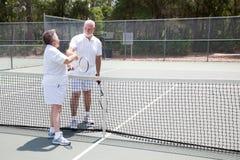 Tennis Seniors Handshake with Copyspace Stock Image